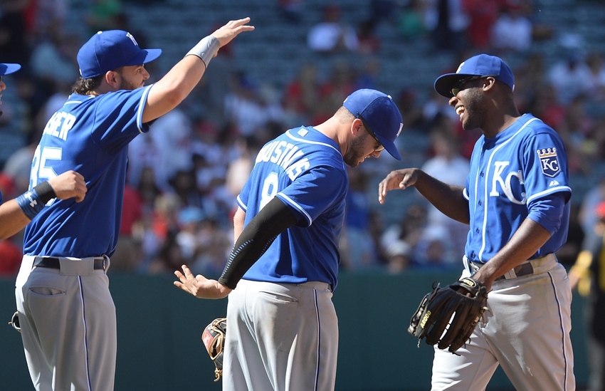 Apr 12, 2015; Anaheim, CA, USA; Kansas City Royals first baseman Eric Hosmer (35) and third baseman Mike Moustakas (8) greets center fielder Lorenzo Cain (6) after they defeated the Los Angeles Angels 9-2 at Angel Stadium of Anaheim. Mandatory Credit: Jayne Kamin-Oncea-USA TODAY Sports